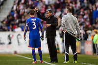 Colorado Rapids head coach Pablo Mastroeni talks with Drew Moor (3). The New York Red Bulls and the Colorado Rapids played to a 1-1 tie during a Major League Soccer (MLS) match at Red Bull Arena in Harrison, NJ, on March 15, 2014.