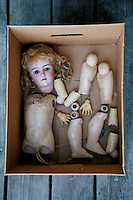 Photo of an old German Handwerck doll in a box all in pieces.
