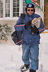 Merrick, New York, U.S. January 3, 2014. A mail carrier for the United States Postal Service USPS delivers mail as a dangerous deep freeze settles in, after a blizzard dumped 6-12 inches of snow on Long Island. The temperature range is 13 to 18 degrees Fahrenheit (-11° to -8° Celsius), with wind gusting up to 45 mph. Wind chill factors make it between 5° F to -10° F (-15° to -23° C), with record lows expected at night.