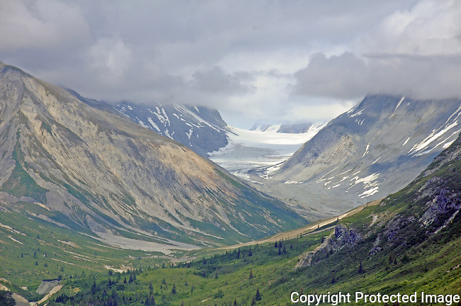 a valley carved out by glaciers, it's mountains shrouded in clouds, in Glacier Bay Nat'l Park