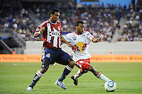 Danleigh Borman (11) of the New York Red Bulls and Dario Delgado (12) of Chivas USA go for the ball. The New York Red Bulls defeated Chivas USA 1-0 during a Major League Soccer (MLS) match at Red Bull Arena in Harrison, NJ, on June 5, 2010.