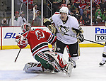 Mar 17, 2010; Newark, NJ, USA; Pittsburgh Penguins left wing Matt Cooke (24) hits New Jersey Devils goalie Martin Brodeur (30) during the first period at the Prudential Center.