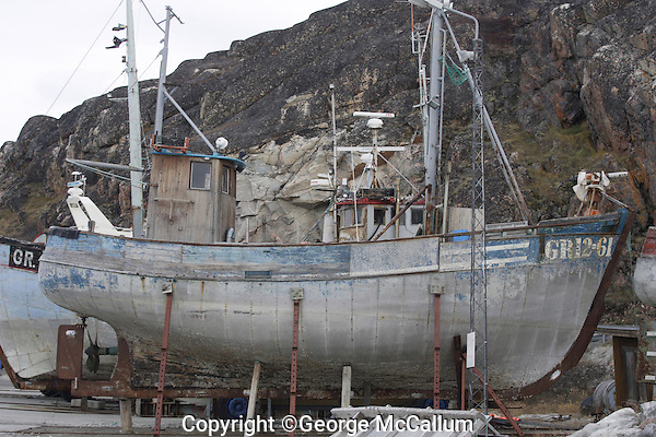 Small Coastal whaling boat on Dry land, Ilulissat, Disco Bay Greenland.