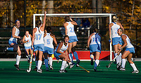 Teryn Brill (1), Elizabeth Stephens (17), Jaclyn Gaudioso Radvany (31), and Kelsey Kolojejchick (14) of UNC celebrate a goal during the NCAA Field Hockey Championship semfinals in College Park, MD.  North Carolina defeated Virginia, 4-3, in overtime.