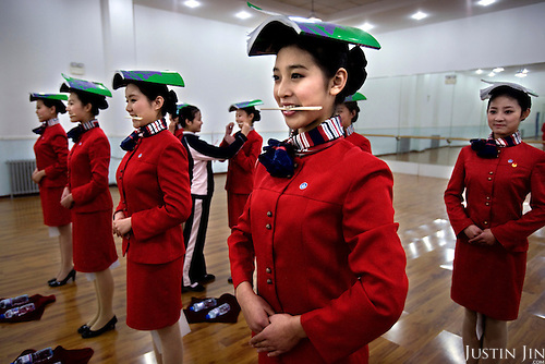 Olympic student volunteers learn to smile and stand straight at a vocational school in Beijing, which is getting ready to host the 2008 Summer Games.