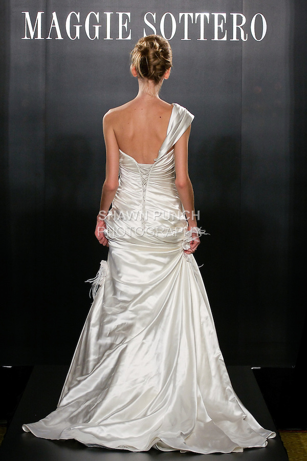 Model walks the runway in a Kristin Couture wedding dress from the Maggie Sottero Bridal Spring 2012 collection, during  Couture: New York Bridal Fashion Week 2012