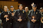 Area law enforcement officers Blain Lynch, Dustin Lobdell, Tony Ryan and Don Banner, l to r, attends a candle light prayer virgil at the Champion's Centre in Tacoma WA for four Lakewood Police officers killed at a Lakewood coffee shop on Sunday, Nov. 29, 2009.  At about 8:00 a.m. Sunday morning, a gunman walked into the Forza Coffee shop and while the four police officers were having coffee before their shift started, he opened fire, killing all four law enforcement officers.  Jim Bryant Photo. ©2010. ALL RIGHTS RESERVED.