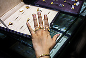 A customer tries on gold rings at a Mehrasons Jewellers store in New Delhi, India. Photo: Sanjit Das/Panos Pictures
