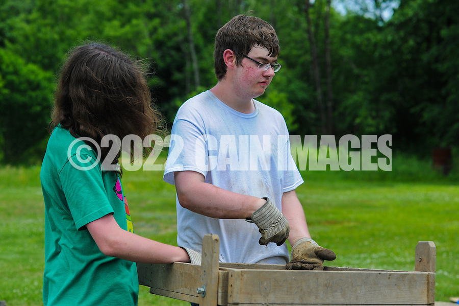 HAZLETON, PA - JUNE 30:  Jonathan Nick (L) and Adam Yeager (R) work at the site of an archaeologic dig June 30, 2014 in Hazleton, Pennsylvania. The team is looking through sites connected with the Lattimer Massacre which occurred in 1897. (Photo by William Thomas Cain/Cain Images)