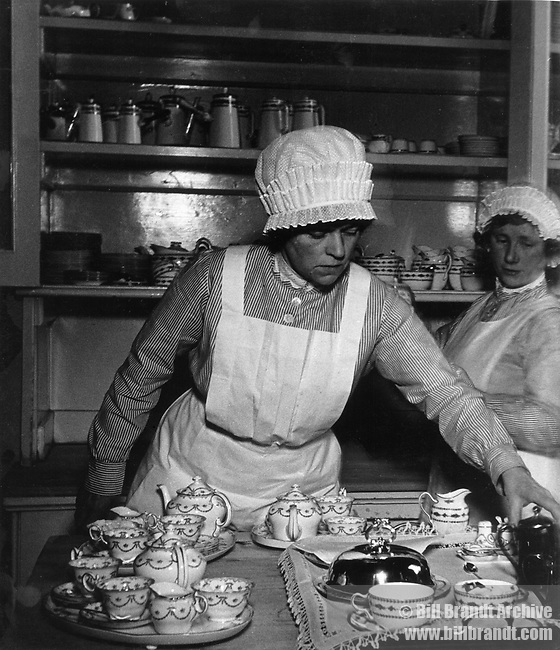 Parlourmaids ready to serve tea, 1939