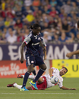 New England Revolution midfielder Shalrie Joseph (21) controls the ball at midfield. In a Major League Soccer (MLS) match, the New England Revolution tied New York Red Bulls, 2-2, at Gillette Stadium on August 20, 2011.