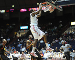 "Ole Miss' Jamal Jones (3) dunks as Grambling State's Demetri Wheeler (23) defends during the first half at the C.M. ""Tad"" Smith Coliseum in Oxford, Miss. on Monday, November 14, 2011.."