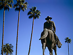 John Waye statue on horseback with palm trees in Beverly Hills