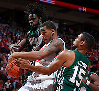 Ohio State Buckeyes center Amir Williams (23) is guarded on a rebound by Ohio Bobcats forward Maurice Ndour (5) and Ohio Bobcats guard Nick Kellogg (15) during Tuesday's NCAA Division I basketball game at Value City Arena in Columbus on November 12, 2013. (Barbara J. Perenic/The Columbus Dispatch)