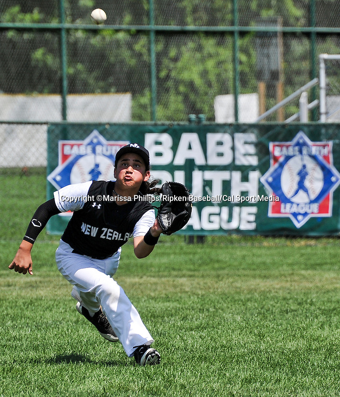 August 13, 2014: New Zealand's Huriwaka Repia (7) makes a catch against Australiaduring the Cal Ripken 12u 70-foot World Series at the Ripken Experience powered by Under Armour in Aberdeen, Maryland on August 13, 2014. Marissa Phillips/Ripken Baseball/CSM