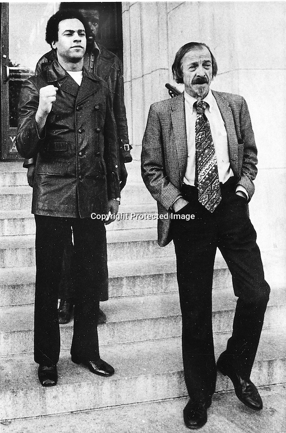 Black Panther Huey Newton leaving the Alameda County court house with his attorney Charles Garry.<br />(1971 photo)