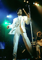 Prince - and guitarist Wemdy Melvoin - performing live on the Parade Tour at Wembley Arena in . London UK- 14 Aug 1986.  Photo credit: George Chin/IconicPix