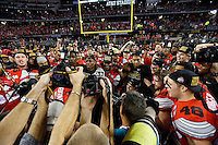 Ohio State Buckeyes celebrate beating Oregon Ducks 42-20 in College Football Playoff Championship game at AT&T Stadium in Arlington, Texas on January 12, 2015.  (Dispatch photo by Kyle Robertson)