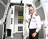Metropolitan Police Commissioner Sir Bernard Hogan-Howe making an announcement about the installation of Close Circuit Television (CCTV) in detainee transport vans.<br />  at Lewisham Police Station, Lewisham, London, Great Britain <br /> <br /> 28th July 2015 <br /> <br /> Commissioner Hogan-Howe viewing a fully equipped CCTV-enabled van.<br /> <br /> Every Borough within the Metropolitan Police Service will have at least one van equipped with CCTV for transporting detainees to custody. So far, 121 vans have been fitted, with the remainder of the fleet due for completion in the coming months. All future vans commissioned by the MPS will have this feature as standard.<br /> <br /> <br /> Photograph by Elliott Franks <br /> Image licensed to Elliott Franks Photography Services