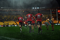The Crusaders run out onto the pitch. Super 15 rugby match - Crusaders v Hurricanes at Westpac Stadium, Wellington, New Zealand on Saturday, 18 June 2011. Photo: Dave Lintott / lintottphoto.co.nz