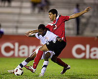 Joseph Amon (12) of the United States tries to slow down Jordan Allen (15) of Canada during the finals of the CONCACAF Men's Under 17 Championship at Catherine Hall Stadium in Montego Bay, Jamaica. The United States defeated Canada, 3-0, in overtime