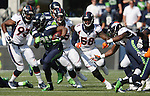 Seattle Seahawks running back Marshawn (24) runs against the   Denver Broncos at CenturyLink Field in Seattle, Washington on September 21, 2014. Lynch rushed for 88 yards and scored two touchdowns in the Seahawks overtime  26-20 win against the Denver Broncos.    ©2014. Jim Bryant Photo. All rights Reserved.