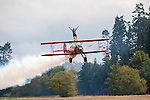 14 year old Weston Mason wing walks on a Stearman biplane, with his father Mike flying the plane. Mike and his wife Marilyn teach wing-walking to students from all over the world. They live in Sequim, WA.