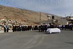 Druze sheikhs gather around a coffin, during the funeral of an elderly woman in Majdal Shams, Golan Heights.