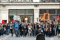 The TUC 'March for the Alternative' attended by over 500,000 people in London. 26-3-11 The protest was against austerity cuts being brought in by the government. There were major scuffles with Police and anarchists and anti cuts protesters smashed political targets and lit fires.