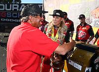 Feb 26, 2017; Chandler, AZ, USA; NHRA top fuel driver Leah Pritchett celebrates with team owner Don Schumacher after winning the Arizona Nationals at Wild Horse Pass Motorsports Park. Mandatory Credit: Mark J. Rebilas-USA TODAY Sports