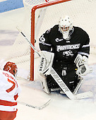 Cason Hohmann (BU - 7) scores on Jon Gillies (PC - 32). - The Boston University Terriers defeated the visiting Providence College Friars 4-2 (EN) on Saturday, December 13, 2012, at Agganis Arena in Boston, Massachusetts.