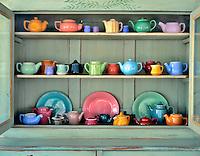 Ceramic teapots in antique cabinet