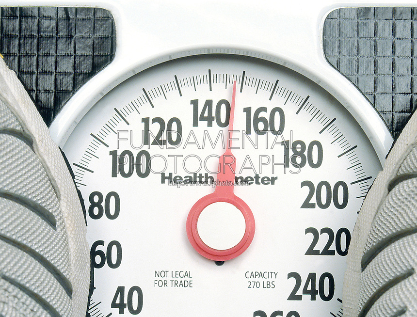APPROXIMATE MEASUREMENT<br /> Person Being Weighed On Scale, Reading 147.7lbs.<br /> A traditional scale does not read tenths of a pound, the reading of 147.7lb must be estimated.