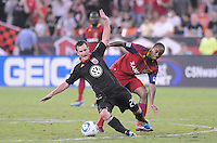 D.C. United Stephen King (20) gets fouled by Real Salt Lake midfeilder Collen Warner (26). D.C. United defeated Real Salt Lake 4-1 at RFK Stadium, Saturday September 24 , 2011.