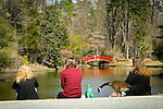 visitors to the Sarah P. Duke Gardens take in the view while a resident Canada goose sneaks a peak into their lunch