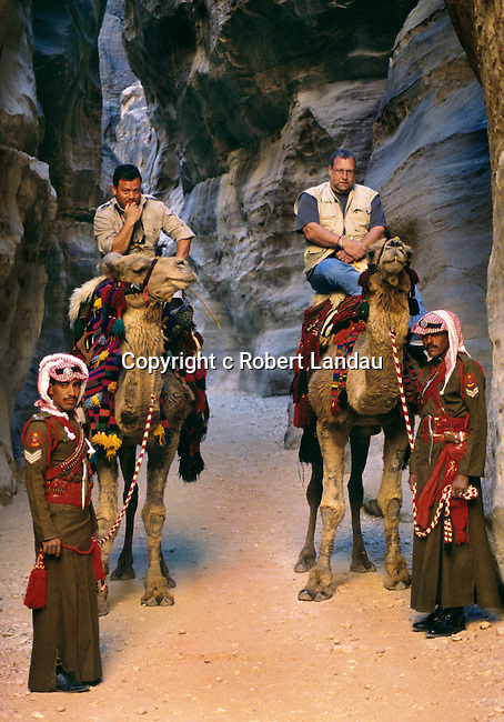 Peter Greenberg with King Abdulah II of Jordan on camel back at the entrance to Petra