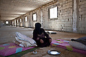 Lebanon - Jdeideh - Wurud, 50-year-old, comes from Zahra. She arrived four months ago with all her family of 22 people, after the Syrian security forces set up a checkpoint close to her house to clash against nearby positions of the Free Syrian Army. ?One day they opened fire on both sides of hour house. I went out and ran through the fields with my children. From distance, I saw our village being destroyed, house by house?, she recounts. Although her village is just few kilometres from the border, it took them six hours t reach it through shelling, bombs and sniper fire. Her husband, a former Arabic teacher, suffered a stroke in Lebanon and is now unable to work. Her sons work as labourers in Lebanon, ?but they are treated like slaves?, she complains. ?They are paid half the money of a Lebanese for double the work?.