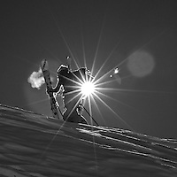 Skier hikes for turns on a tour from Le Tour up to Point de Bron.