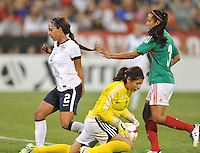 Sydney Leroux (2) of the USWNT goes against Cecilia Santiago (1) of Mexico. The USWNT defeated Mexico 7-0 during an international friendly, at RFK Stadium, Tuesday September 3, 2013.
