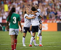 Sydney Leroux (2) of the USWNT celebrates her goal with teammates Abby Wambach (20) and Lauren Holiday (12) during an international friendly at RFK Stadium in Washington, DC.  The USWNT defeated Mexico, 7-0.