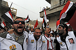 Men during a rally supporting Syrian president Assad, in Majdal Shams, Golan Heights.