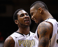 WEST LAFAYETTE, IN - JANUARY 02: Terone Johnson #0 of the Purdue Boilermakers and Jacob Lawson #34 of the Purdue Boilermakers share a laugh in the closing minuets against the Illinois Fighting Illini at Mackey Arena on January 2, 2013 in West Lafayette, Indiana. Purdue defeated Illinois 68-61. (Photo by Michael Hickey/Getty Images) *** Local Caption *** Terone Johnson; Jacob Lawson