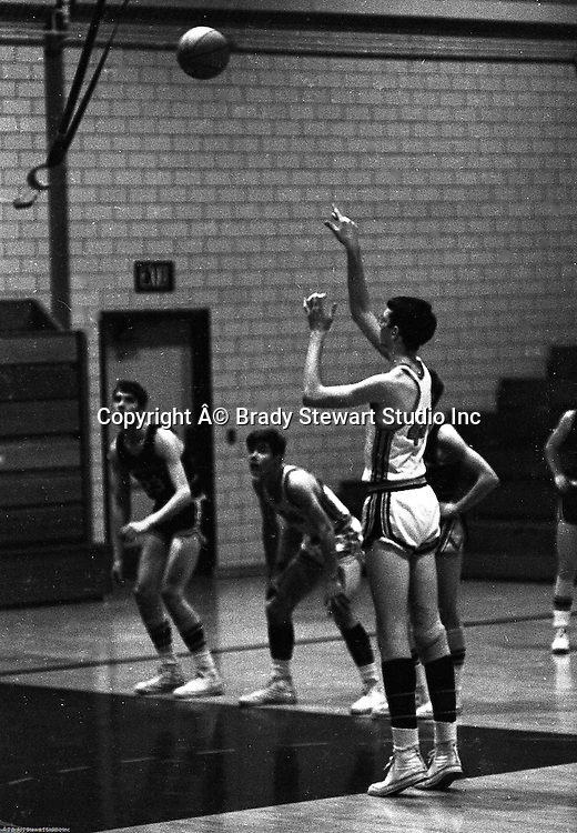 Bethel Park PA:  John Klein 44 shooting a foul shot during a basketball game against the Mt Lebanon Blue Devils at Bethel Park Gymnasium - 1968.  Bruce Evanovich in the background.  The JV Team was coached by Mr. Reno and the Bethel Park JVs won the Section Championship.  The team included; Scott Streiner, Steve Zemba, John Klein, Mike Stewart, Bruce Evanovich, Jeff Blosel and Tim Sullivan.