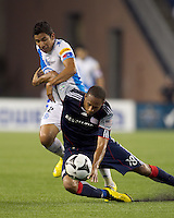 New England Revolution forward Khano Smith (18) dribble attempt fails as Puebla FC midfielder Orlando Rincon (2) defends. The New England Revolution defeated Puebla FC in penalty kicks, in SuperLiga 2010 semifinal at Gillette Stadium on August 4, 2010.