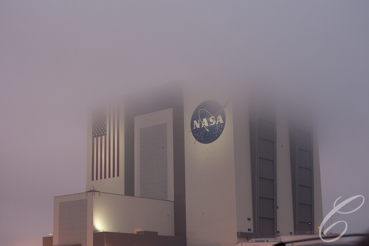 Low clouds shroud the Vehicle Assembly Building (VAB)  at Kennedy Space Center February 24, 2011 on the eve of Discovery's final launch.  Discovery's mission takes it to the International Space Station (ISS) to deliver the PMM module and Robonaut 2.