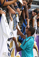 Samuel Eto'o #9 of Inter Milan signs autographs during an international friendly match against Manchester City on July 31 2010 at M&T Bank Stadium in Baltimore, Maryland. Milan won 3-0.