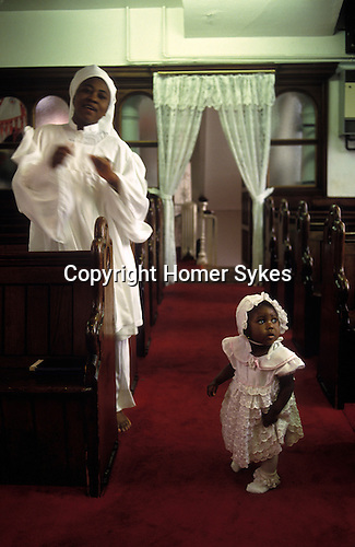 """Brotherhood of the Cross and Star London. Motyher and child she is doing a """"holy dance""""