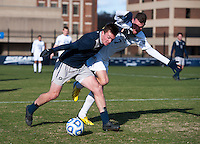 Joey Dillon (4) of Georgetown fights for the ball with Ivan Militar (7) of Old Dominion during the second round of the NCAA tournament at Shaw Field in Washington, DC. Georgeotown defeated Old Dominion, 3-0.