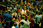 LIFFE, London International Financial Futures Exchange. This  was all pre-computer trading, and is where deals were struck, Derivates, Options and Futures were bought and sold by shouting across the trading floor know at the 'Bear Pit' and frantic gesturing. They wore different coloured jackets so that colleagues could pick each other out in the frenzy of a days work.