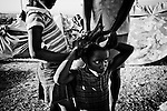 A girl has her hair styled by friends in a camp for those displaced by the recent earthquake in Petionville, outside Port-au-Prince, Haiti.